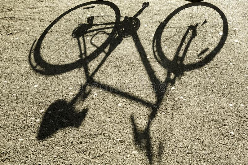 Shadow of the bicycle. Shadow of bicycle on the street stock photos