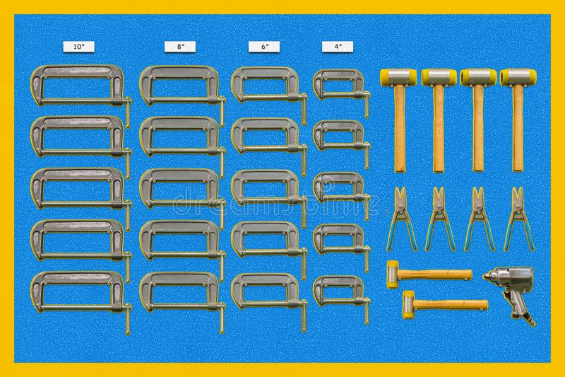 Multiple tools shadow board. Shadow board for C-clamps ,plastic hammers, snips and air impact wrench stock photo