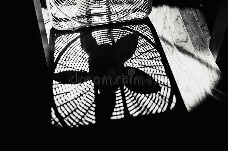 Shadow of a Box Fan on a Wood Floor royalty free stock photo