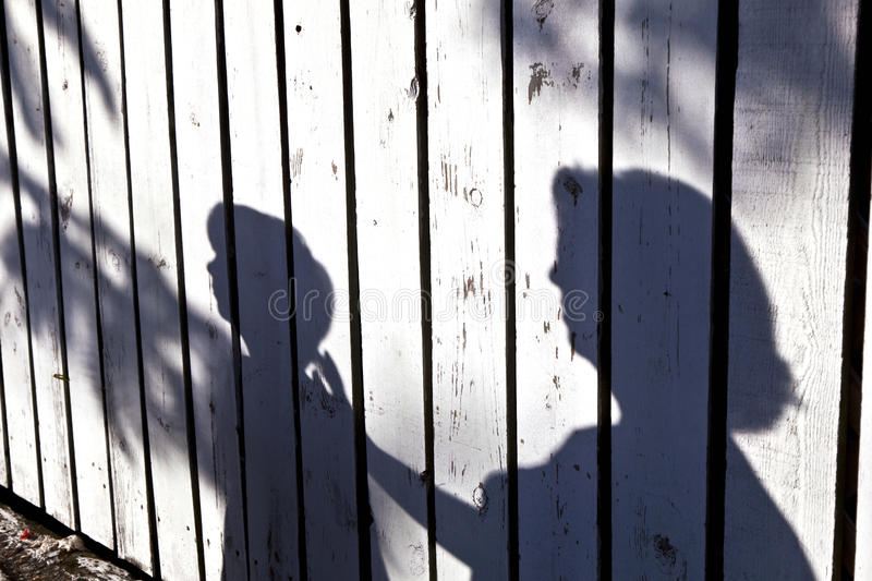 Shadow of a boy with mother stock photos
