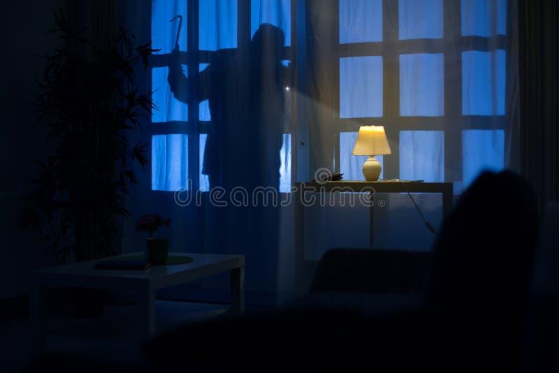 Shadow of burglar. On the balcony door royalty free stock images