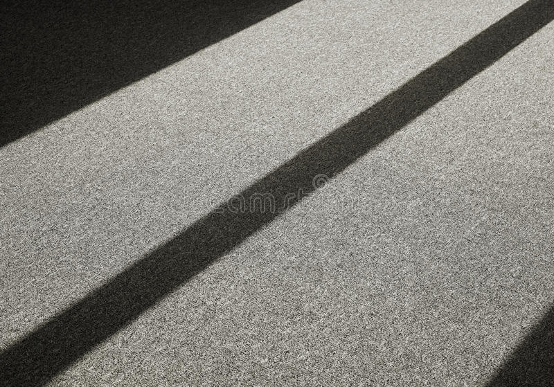 Shadow on a carpet floor stock photography