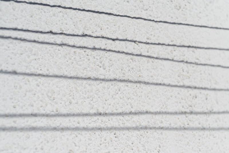 Shadow of clothesline on the wall. Slovakia. Shadow of clothesline on the wall of house during sunny day. Slovakia stock photos