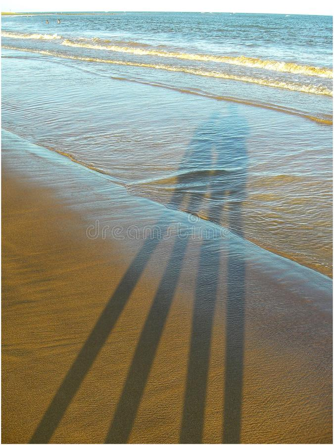 Shadow of Couple on Brazilian Beach royalty free stock photo
