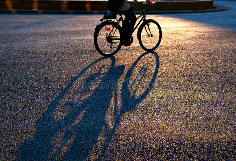 Shadow of cyclist stock photo