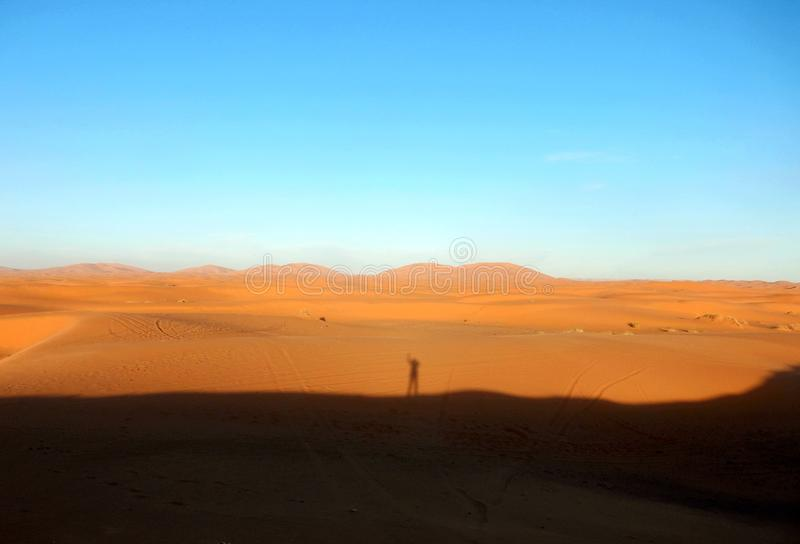 Shadow in the desert Sahara. The Sahara is the largest hot desert and the third largest desert in the world after Antarctica and the Arctic. Its area of 9,200 stock photo