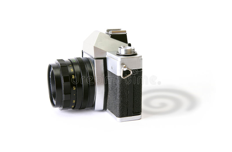 Shadow Of Dreamstime. A camera with Dreamstime logo as its shadow