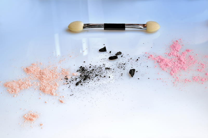 Shadow eye and brush applicator. On glass table royalty free stock image
