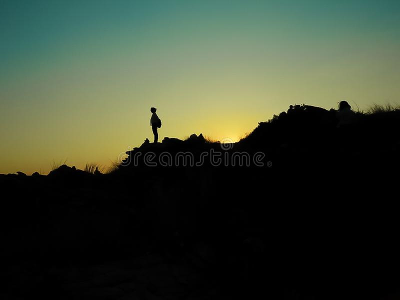 Shadow of girl standing on the mountain. stock photography