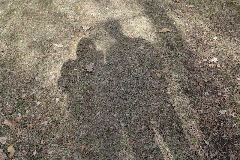 The shadow on the ground pair lyday. Spring day stock photography