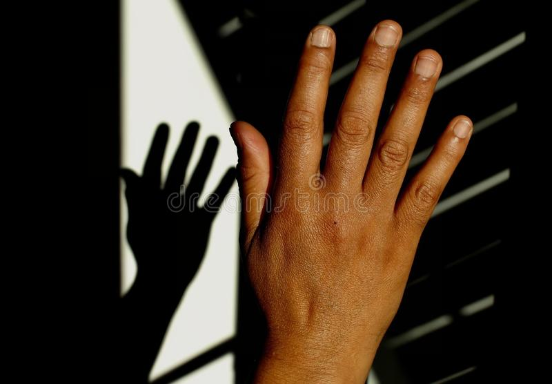 He photo of The shadow of the hand royalty free stock photo