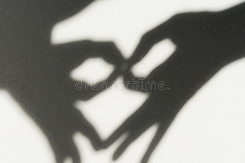 Shadow of the hands on the wall shows a ghost royalty free stock photos