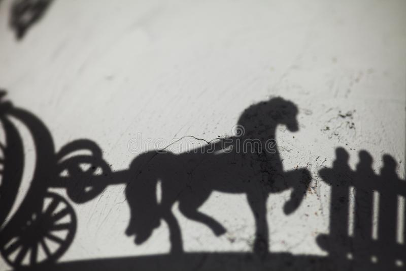 Shadow of a horse cart stock photo
