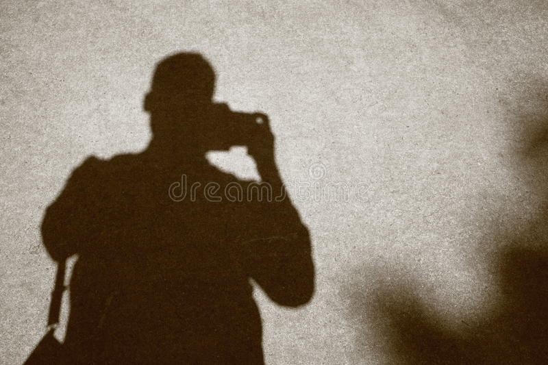 Shadow image of photographer on concrete royalty free stock images