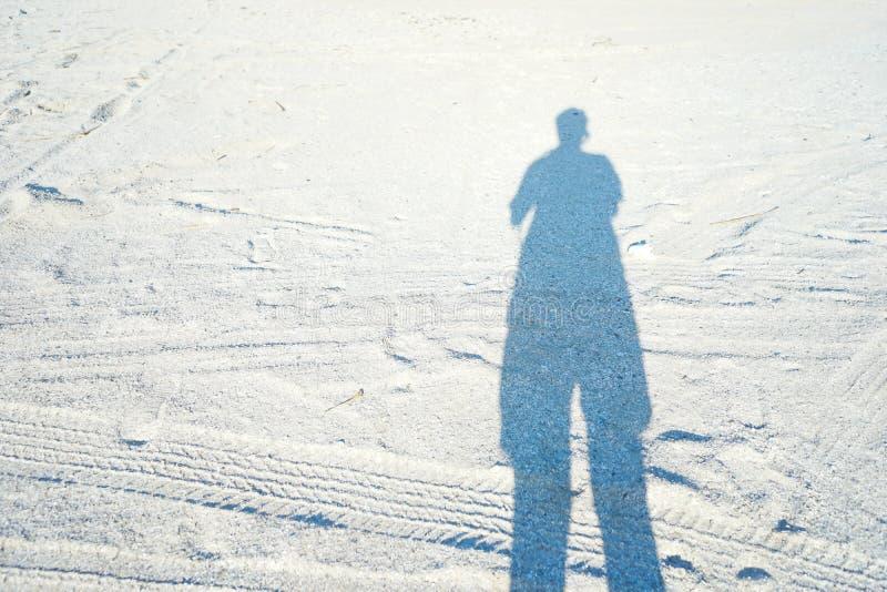 Shadow image. On white sand royalty free stock photo