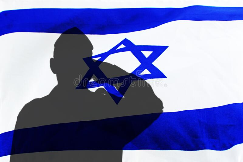 Shadow of an Israeli soldier saluting the flag of Israel. Topics photo: Israeli army, Memorial Day for Israel`s Fallen Soldiers. Shadow of an Israeli soldier royalty free stock photography