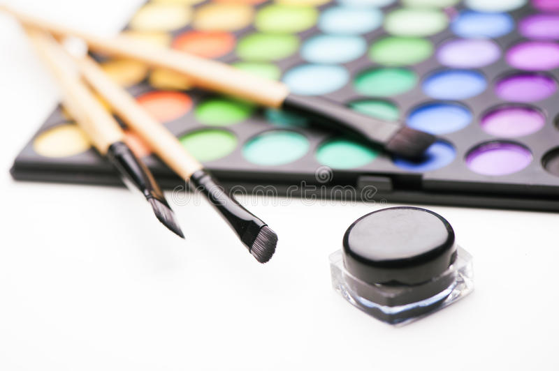 Shadow kit with brush for make-up. Close up royalty free stock image