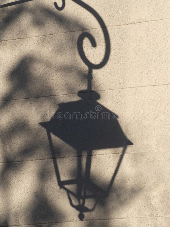 Shadow of a lamp post stock images