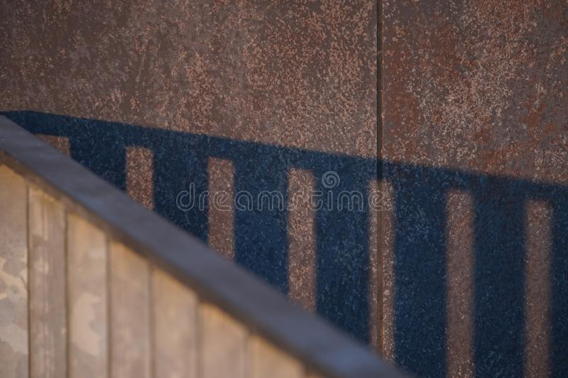 Shadow lines in the evening. The play of light and shadow from the frame structures on the surface of paving stones. deception of stock photography