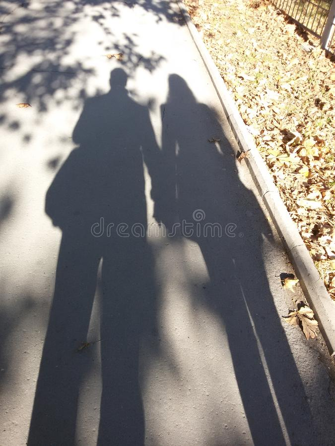 Shadow of lovely couple royalty free stock photos