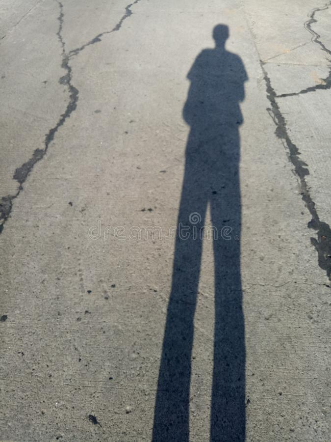 Shadow of a man on a street royalty free stock photo