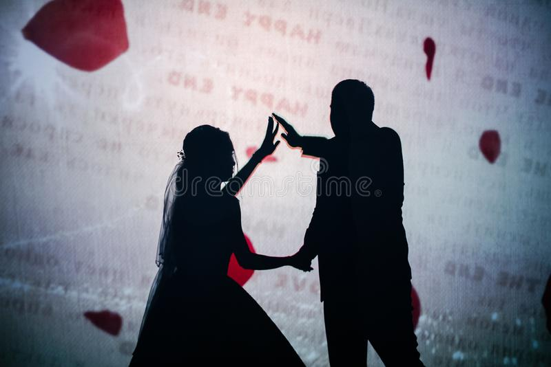 The shadow of a man and a woman in the photo stock images