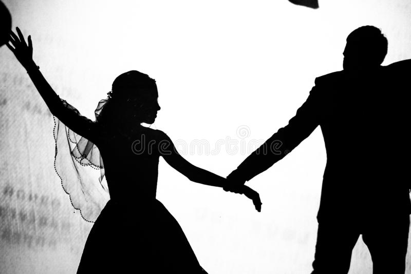 The shadow of a man and a woman in the photo royalty free stock image