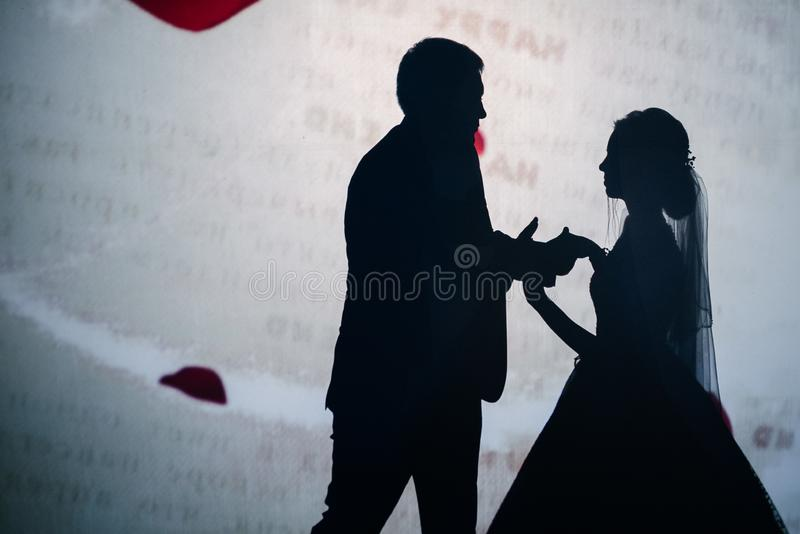 The shadow of a man and a woman in the photo royalty free stock photography