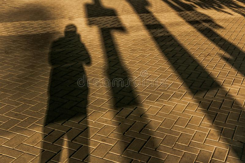 Shadow men on the road. Photo royalty free stock images