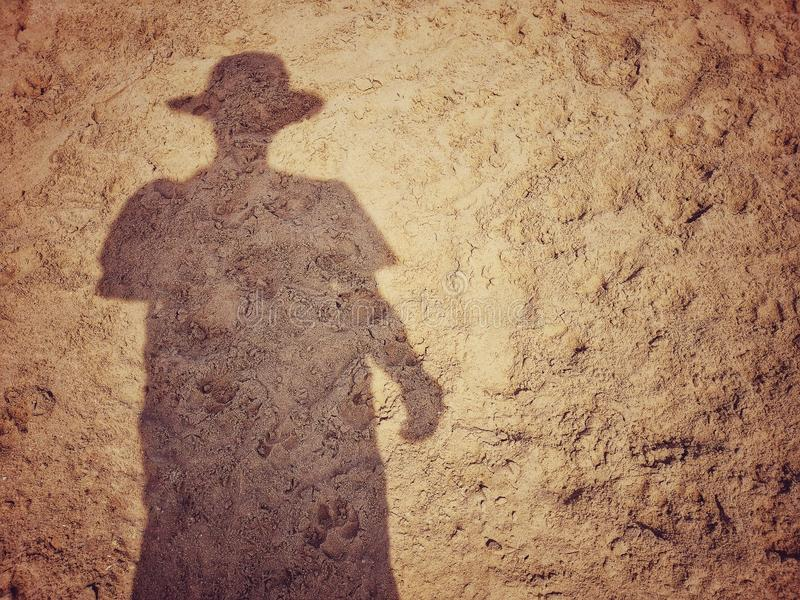 Shadow of a men on sand beach royalty free stock photos