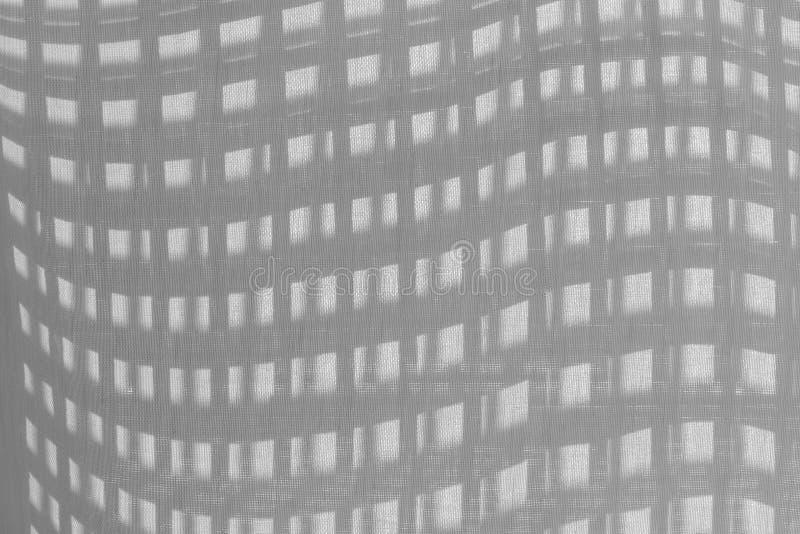 Shadow of mesh on fabric stock photo