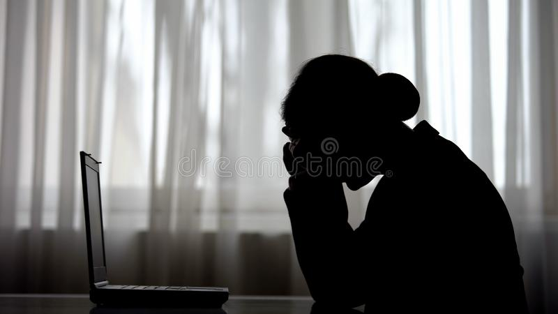Shadow of overworked woman putting head on hands, tired of night work, deadline stock images