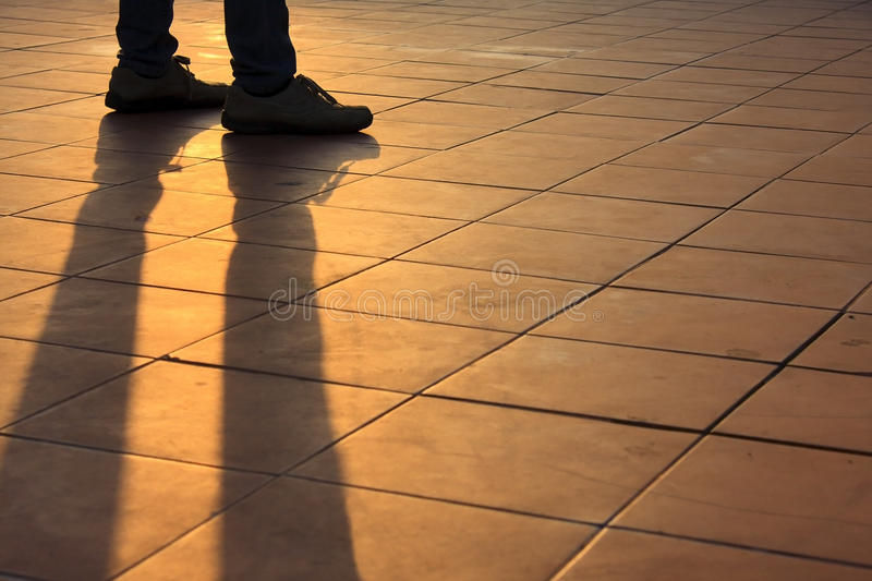 Shadow people. Golden evening sunlight stock photography