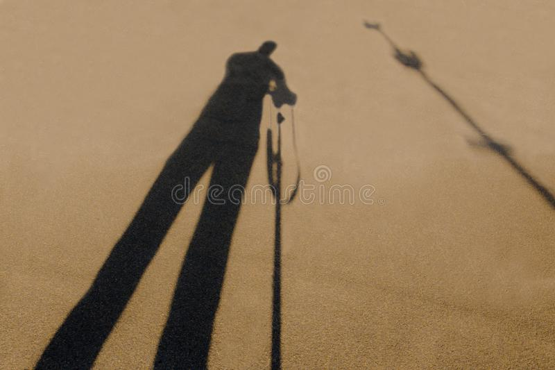 The shadow of the photographer while photographing the object royalty free stock photo