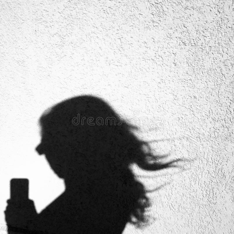 Shadow's selfie of a young woman royalty free stock photo