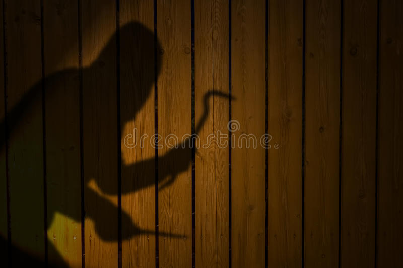 Shadow or silhouette of thief on fence stock image