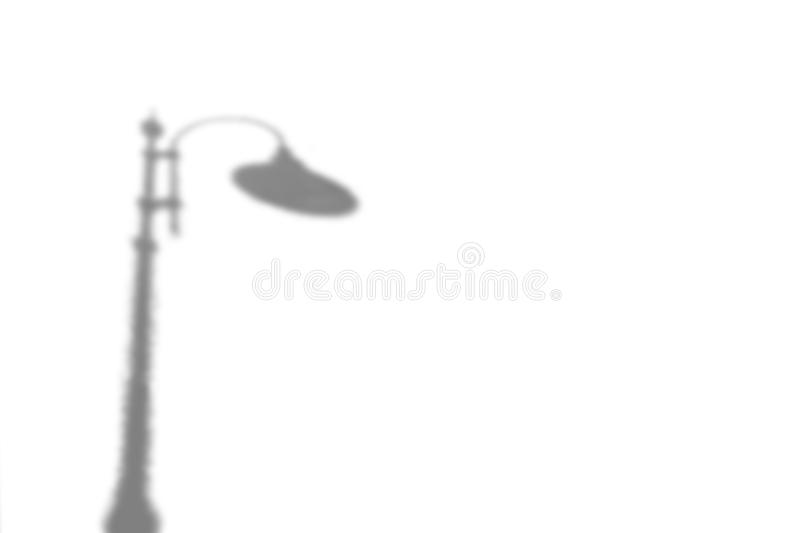 The shadow of a street lamp. Black and white image to overlay the photos or the mockup royalty free stock photos