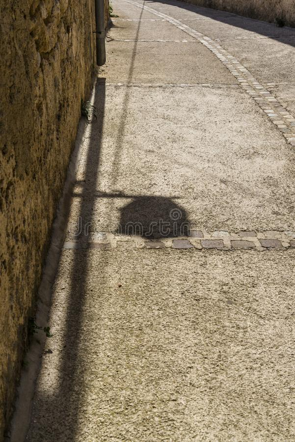 Shadow of a street lamp stock photo