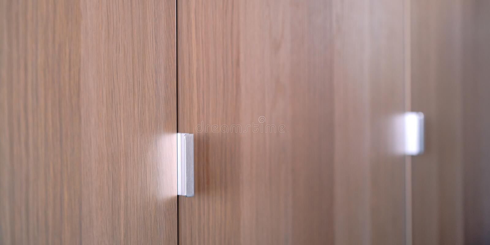 The shadow of the sun blinds on the doors of wardrobe.  royalty free stock photography