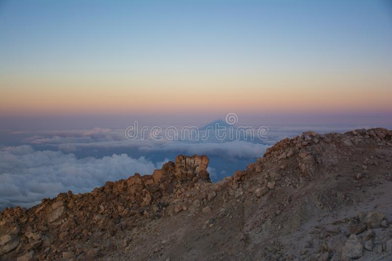 The shadow of Teide Mount at sunrise. Beautiful view from the to royalty free stock images