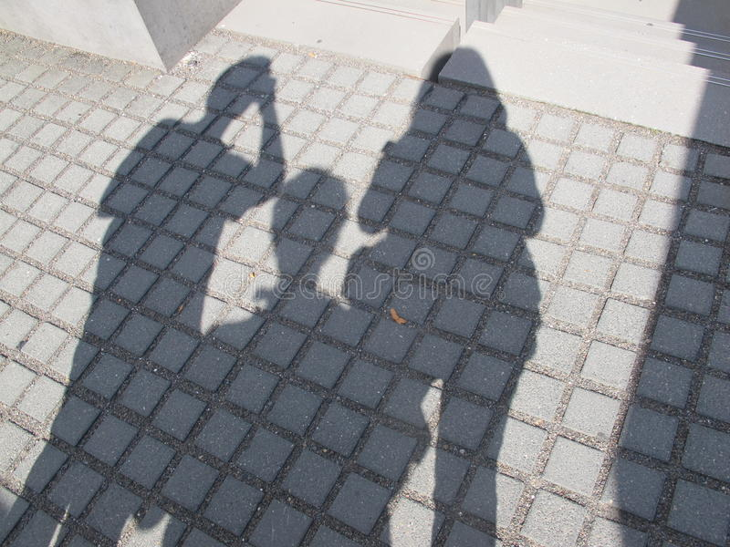 Shadow of Three People stock photos