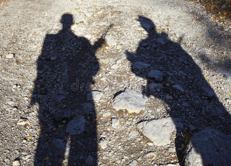 Shadow of two armed men. On the ground the shadow of two armed men stock photography