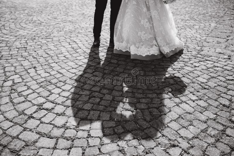 Shadow of two people kissing outside. pavement. Shadow of two people kissing outside stock images