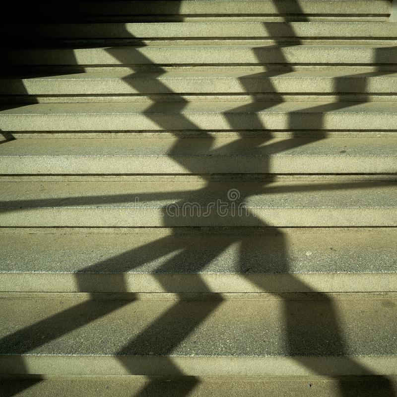 Shadow of a window grille on the stairs royalty free stock photography