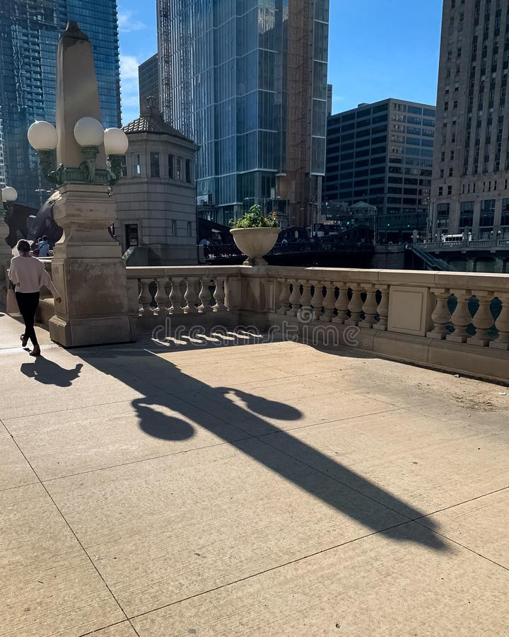 Shadow of woman and light fixture in Chicago Loop royalty free stock photos