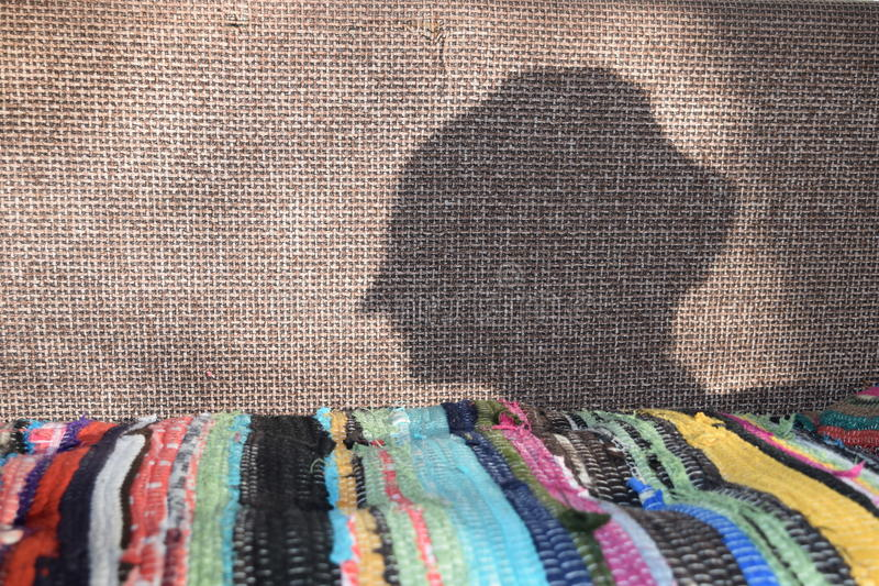 The shadow of a womans head. The shadow of the head of a beautiful woman, the Arab motifs stock photography