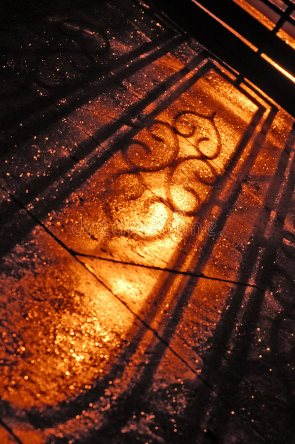 Shadow of wrought iron fence stock images