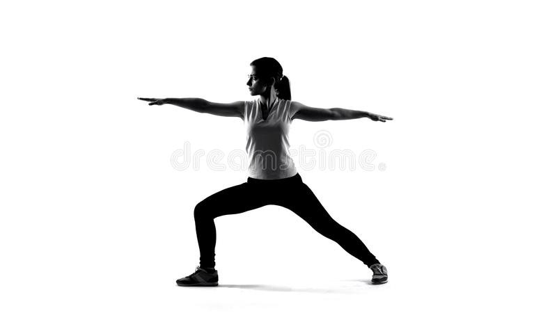 Shadow of young woman making yoga exercises and meditating, sport healthcare royalty free stock photography