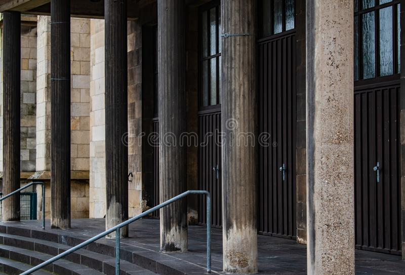 Shadowed and aged stone pillars of gothic church stock photo