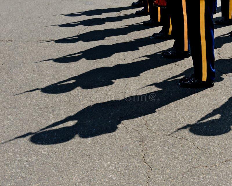 Shadows. Horizontal photo of military honor guards' shadows with rifels and bayonets royalty free stock photo